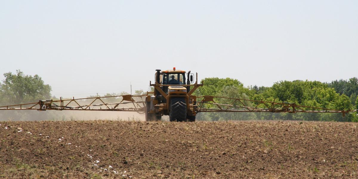 Liquid terragator spreading probable human carcinogen on food crops