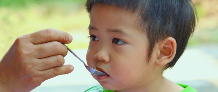 child eating rice