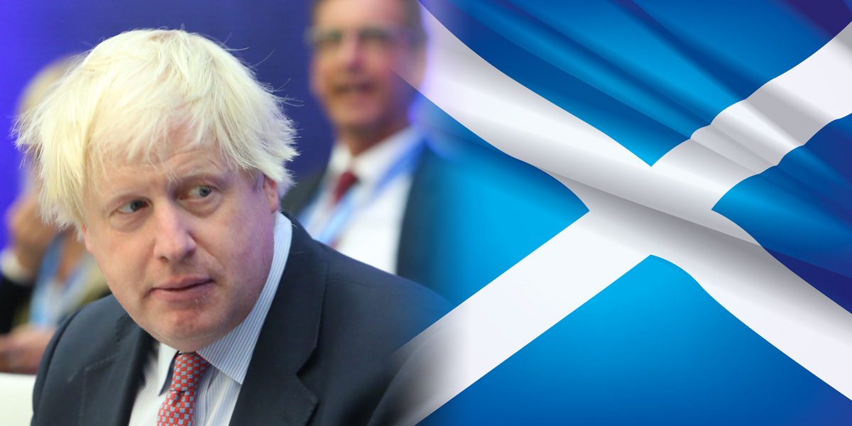 Boris Johnson looking at Scottish Flag