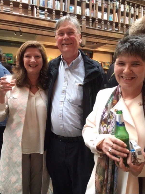 Fiona Fox and her sister Claire with a smiling Tim Hunt