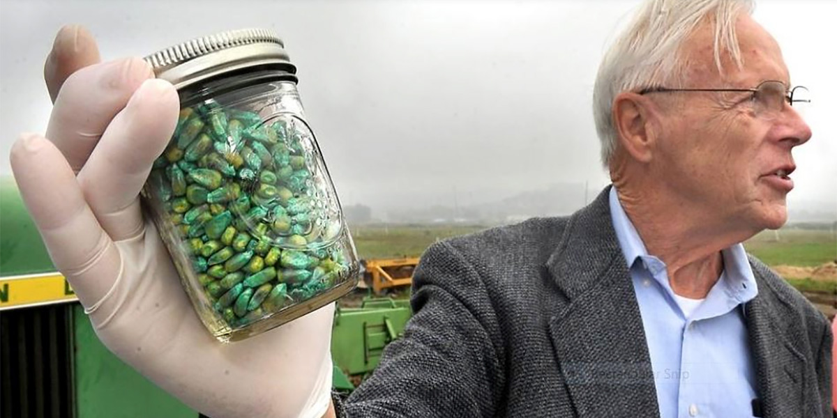 Ramon Seidler holding a jar of GM Maize