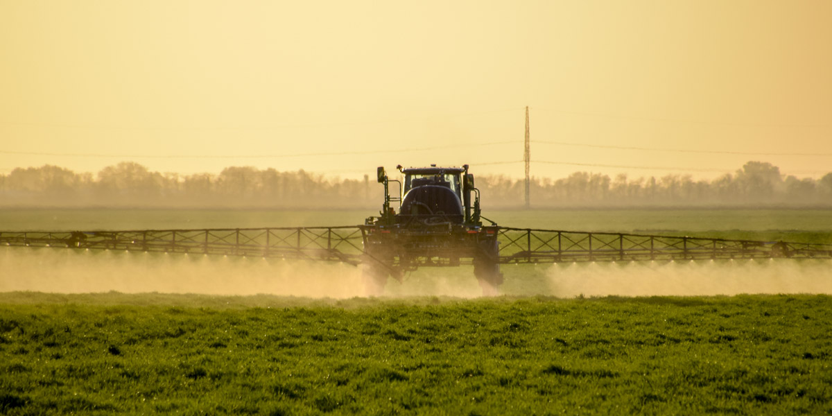 Tractor spraying roundup gylphosate