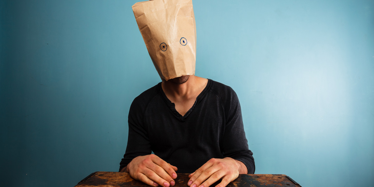 man with bag over his head